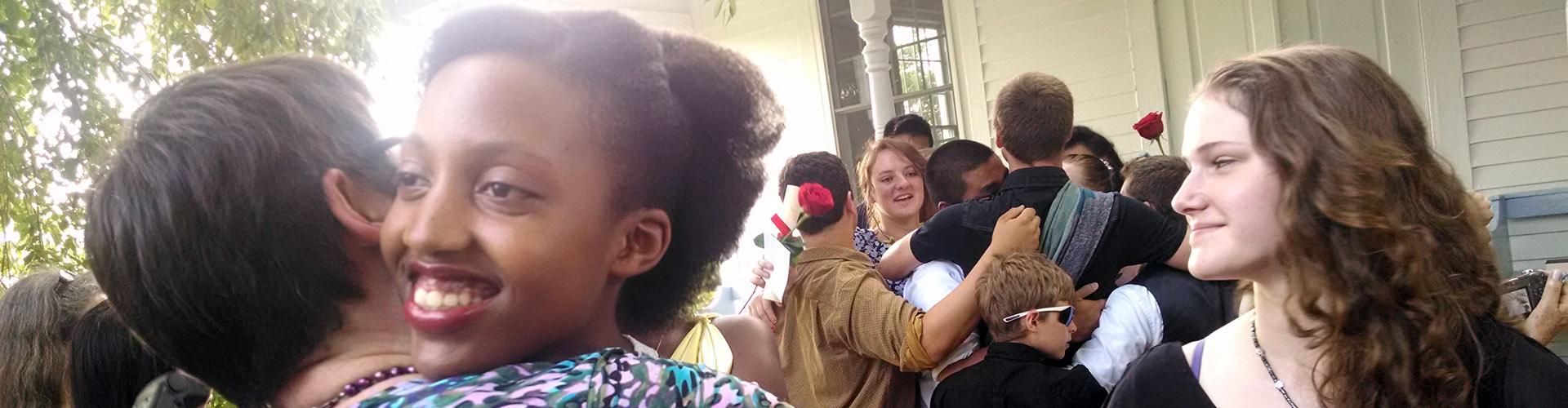 Scattergood graduation hug with Sharon