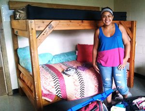 A student on dorm move-in day